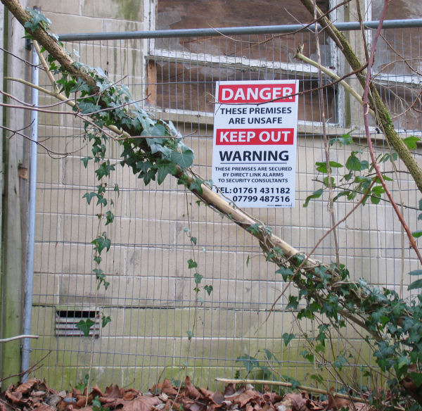 Peradins Warning notice on fence at the Freshford Mill site currently owned by Suttons