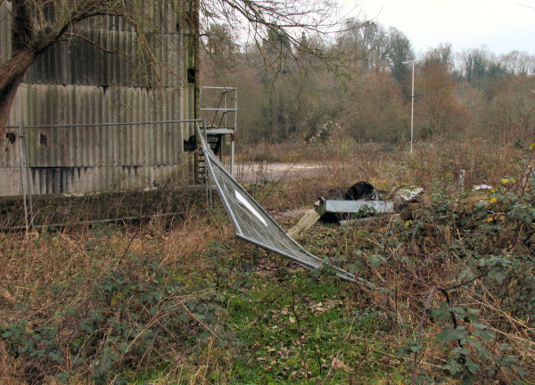 asbestos clad b uilding and fallen fencing Freshford Mill adjoining field with public access