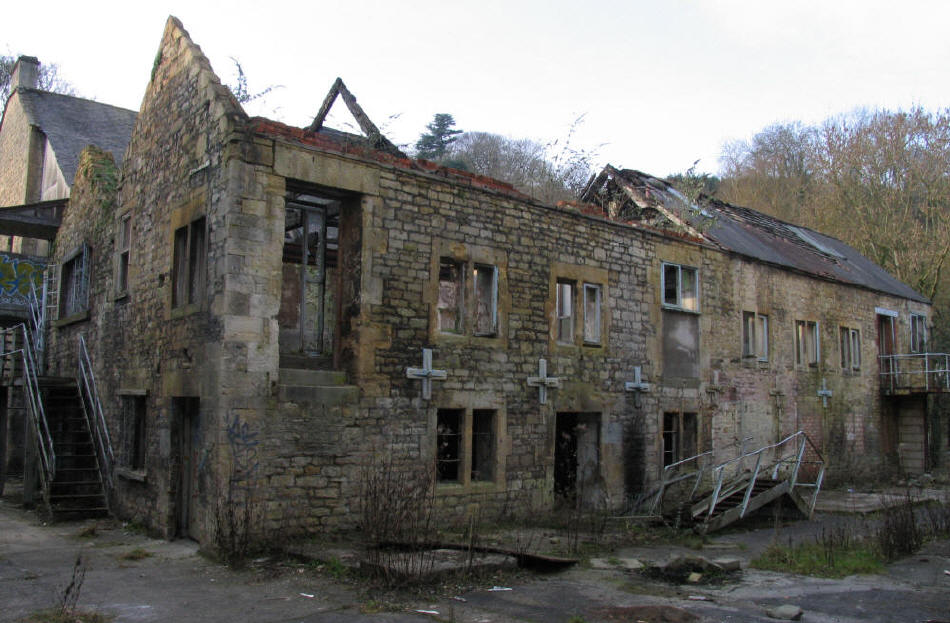 Substantial old building in state of disrepair at Freshford Mill