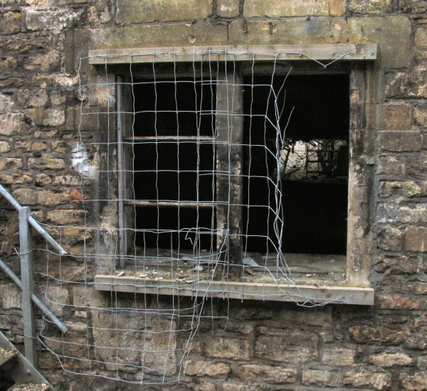 window with poor security measures at Freshford Mill Somerset