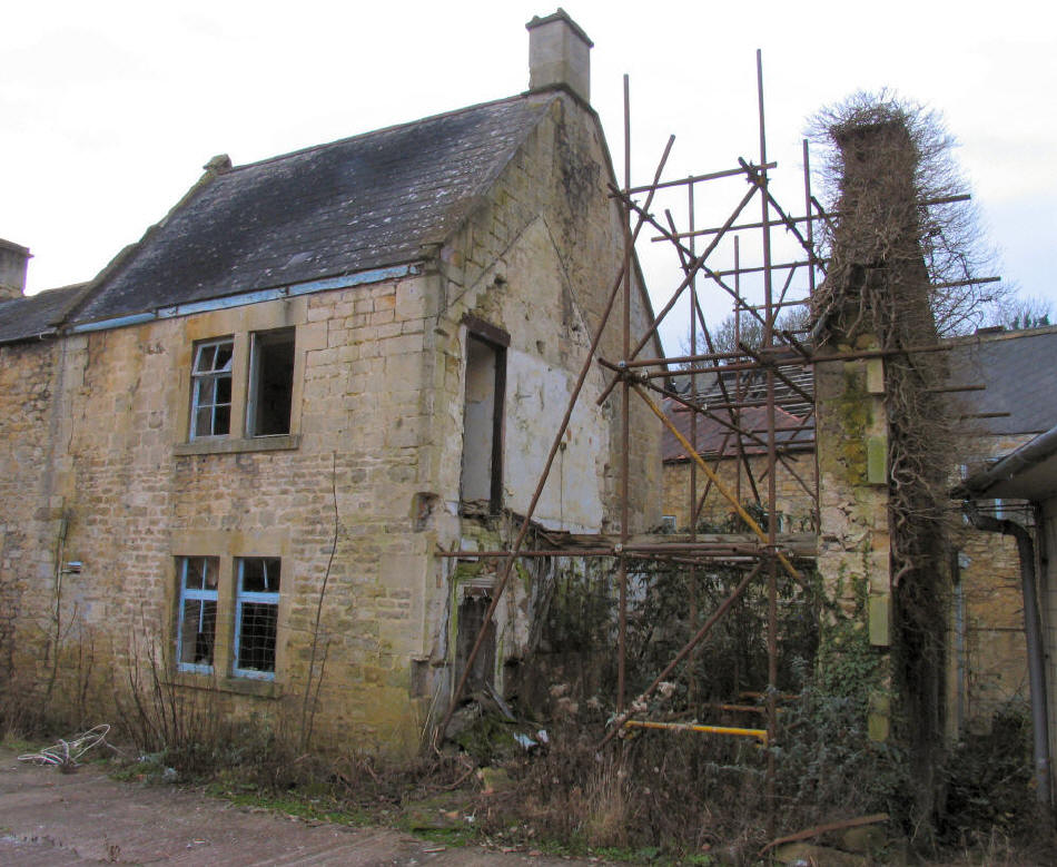 old building Freshford Mill Somerset with measures taken to retain gable wall